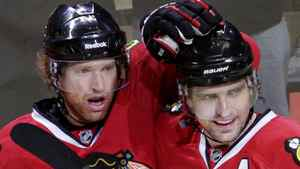 Chicago Blackhawks Brian Campbell (L) celebrates his goal against Vancouver Canucks with team mates Patrick Sharp (C) and Jonathan Toews during the second period in Game 4 of their NHL Western Conference quarter-final hockey game in Chicago, April 19, 2011. REUTERS/John Gress