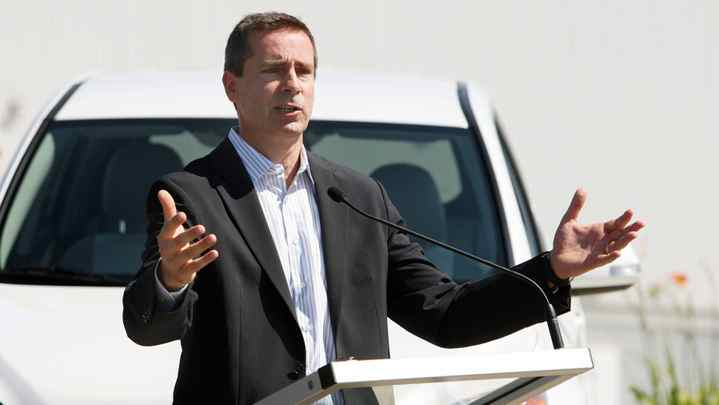 Ontario Premier Dalton McGuinty answers questions in front of a Toyota RAV4 EV (electric vehicle) on display for the announcement that the Toyota Woodstock plant is being chosen to produce the vehicle in Woodstock, Ont.,