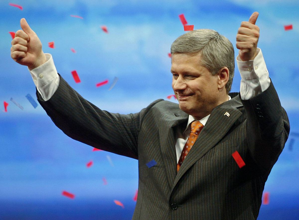 Conservative Leader Stephen Harper salutes the crowd after a victory speech at his Calgary election headquarters on Oct. 14, 2008.