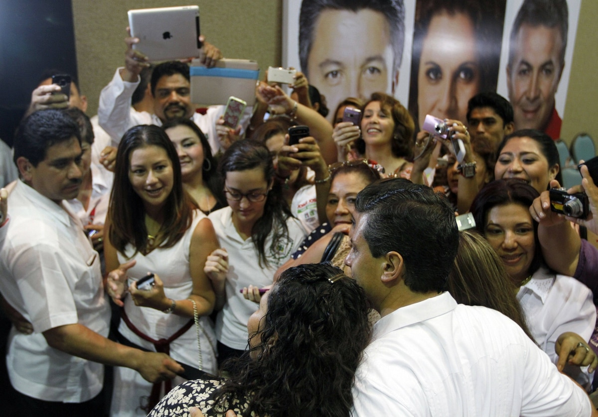 Mexican presidential candidate Enrique Pena Nieto, of the Institutional Revolutionary Party (PRI), poses before a group of admirers at a campaign stop in Ciudad del Carmen, Campeche, Mexico on May 16, 2012.