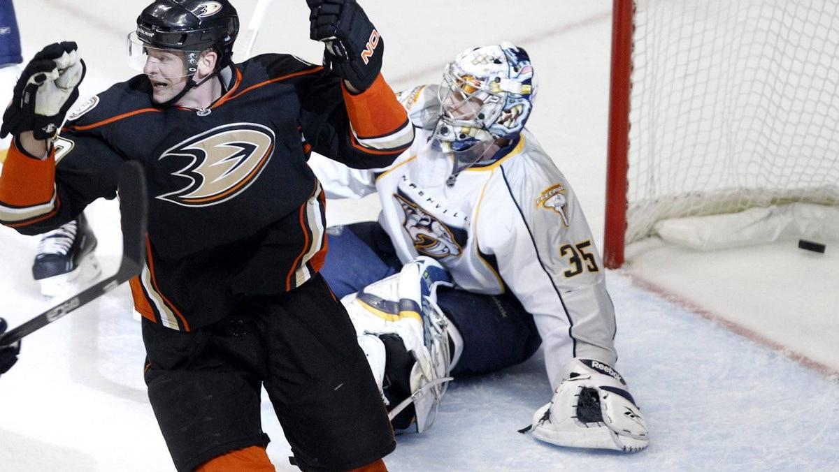 Anaheim Ducks Corey Perry (L) celebrates as a goal scored by Teemu Selanne (not shown) goes into the net past Nashville Predators goalie Pekka Rinne. REUTERS/Lucy Nicholson