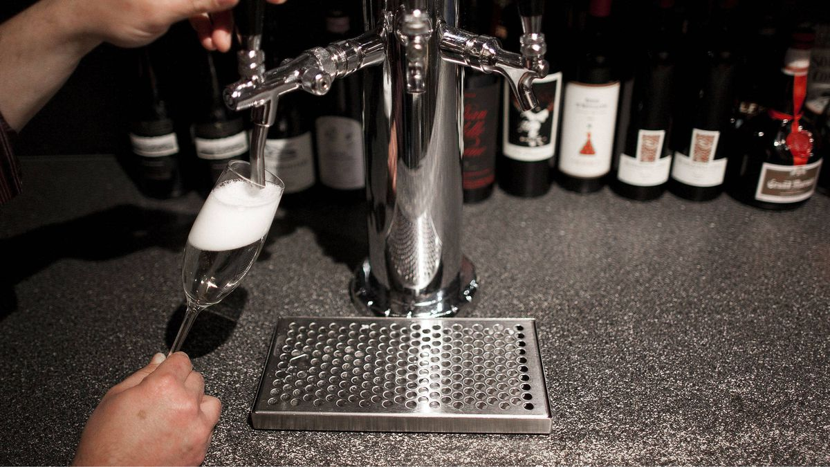 Michael Mameli, Owner and General Manager of Lupo Restaurant, pours a glass of Montelvini sparkling wine from a tap at Lupo Restaurant in Vancouver.