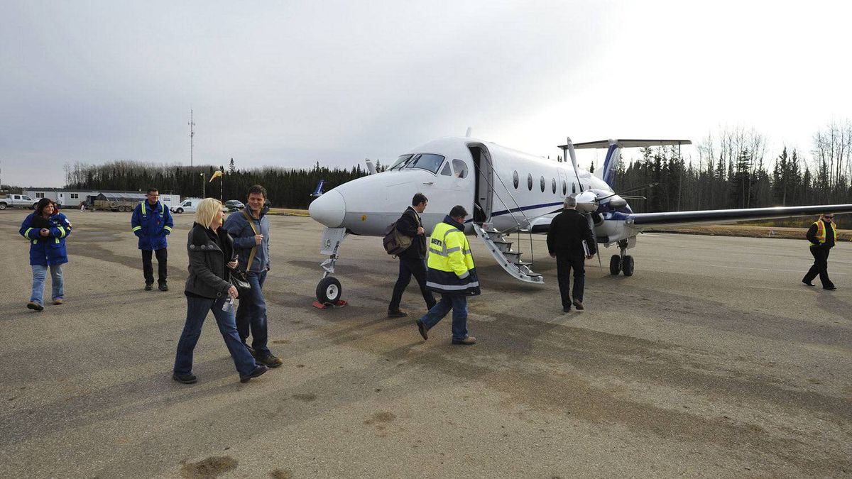 Staff from Devon load a North Cariboo Aircraft at the new Devon airport near Conklin, Alta., October 28, 2011.