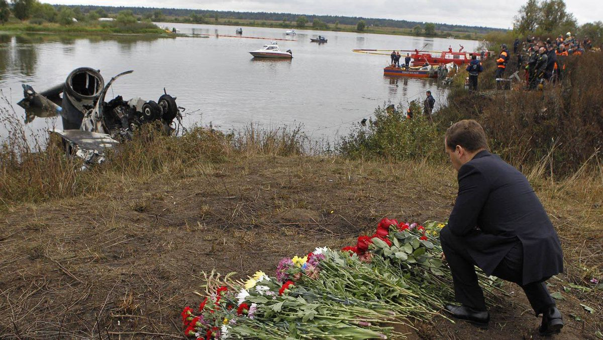 Russian President Dmitry Medvedev lays flowers at the site of a plane crash on the bank of the Tushna River near the city of Yaroslavl, 300 kilometres northeast of Moscow, on Sept. 8, 2011.