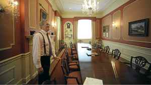 Michael Smedley, Morgan Meighen's chief portfolio officer, stands in the renovated boardroom at 10 Toronto Street. All that remains of the grand room are the original table and chairs. Oil paintings of former proprieters such as E.P. Taylor and Bud McDougald have been auctioned. In their place hang portraits of former Morgan Meighen owners Louise Morgan and Maxwell Meighen, son of Canada's ninth prime minister Arthur Meighen.