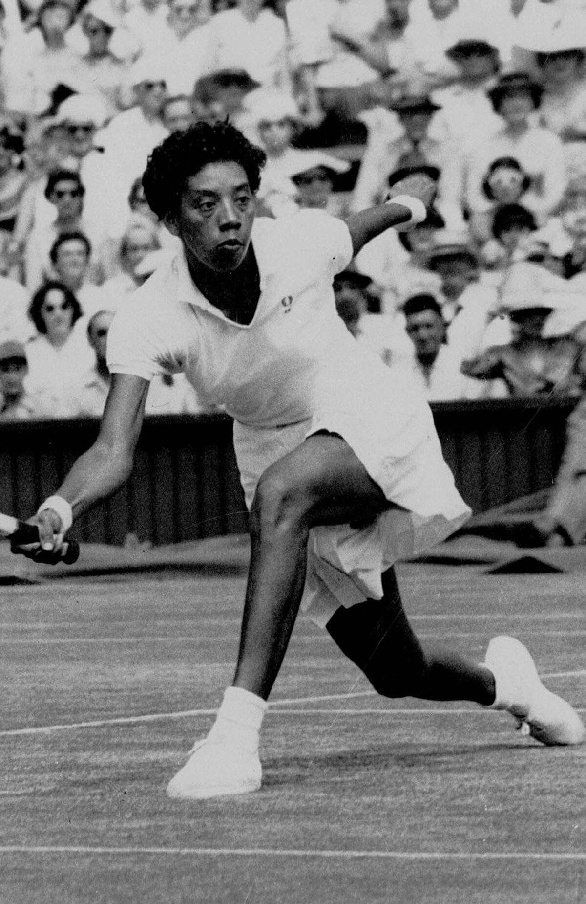 Althea Gibson makes a return to Darlene Hard during their title match at Wimbledon, which Gibson won 6-3, 6-2, in this July 6, 1957, file photo. Gibson, a champion tennis player in the 1950s who was the first black to win Wimbledon and U.S. national titles, died Sunday, Sept. 28, 2003. She was 76. Gibson had been seriously ill for years and died at East Orange General Hospital, where she had spent the last week, according to Darryl Jeffries, a spokesman for the city of East Orange, N.J.