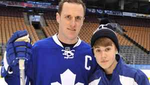 Justin Bieber poses for a photo with Maple Leafs captain Dion Phaneuf Wednesday Dec. 21, 2011, in Toronto. Bieber joined the Toronto Maple Leafs to skate with the Childrens Wish Foundation Of Canada. CP/ HO- MuchMusic