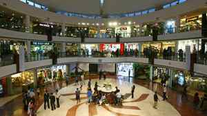 People wander around a shopping mall during the evening in New Delhi.