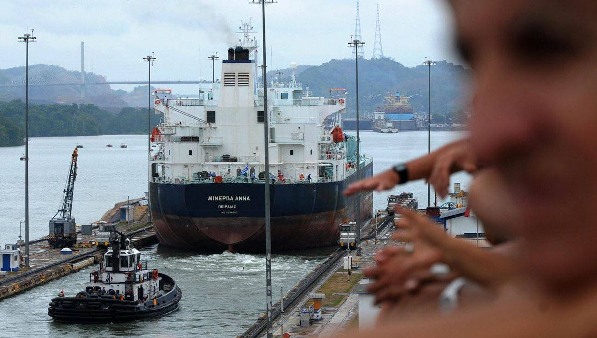 A ship goes through the Miraflores locks of the Panama Canal