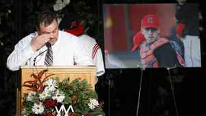 Prairie Baseball Academy head coach Todd Hubka wipes away a tear as he speaks at a memorial for Tabitha Stepple, Mitch McLean and Tanner Craswell, in Lethbridge, Alta., Saturday, Jan. 14, 2012.