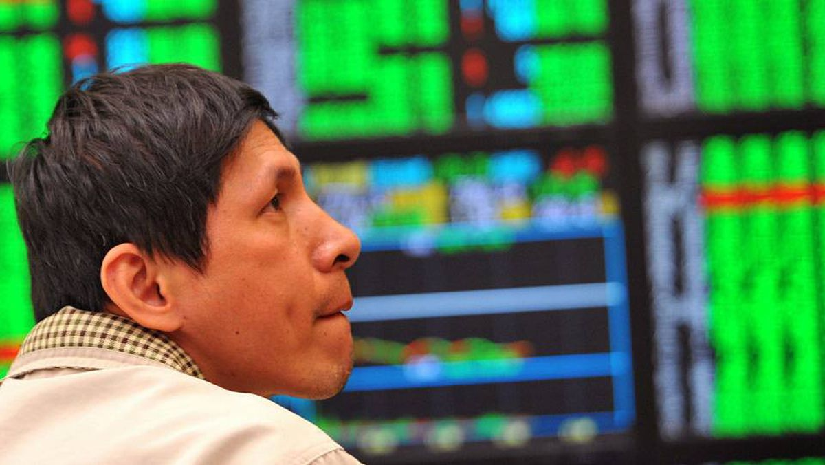 An investor watches electronic screens in a securities trading house in Taipei as Taiwan's weighted index tumbles more than 2 per cent.