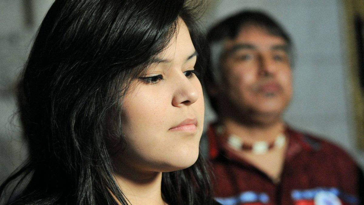 Chelsea Edwards, a friend of the late Shannen Koostachin, and Ms. Koostachin's father Andrew, address a Parliament Hill news conference on Feb. 27, 2012.