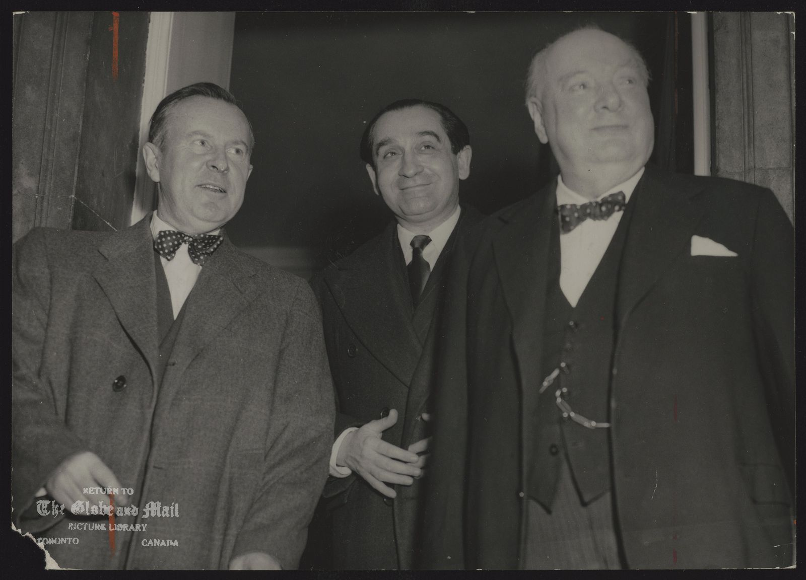 LESTER B. PEARSON (With famous people) Lester B. Pearson with Mendes France and Sir Winston Churchill. [In London for a meeting, Pearson lunches with Pierre Mendes-France and Sir Winston Churchill.]