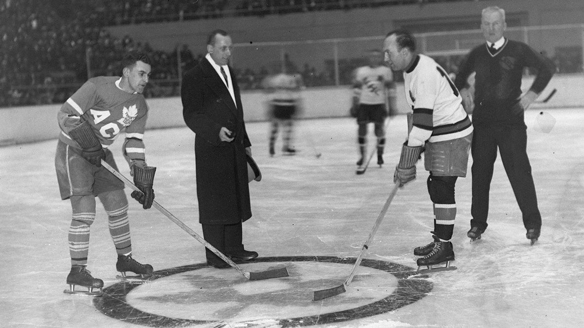 Joe Primeau, left, was a player before he was coach of the Toronto Maple Leafs from 1950-1953.