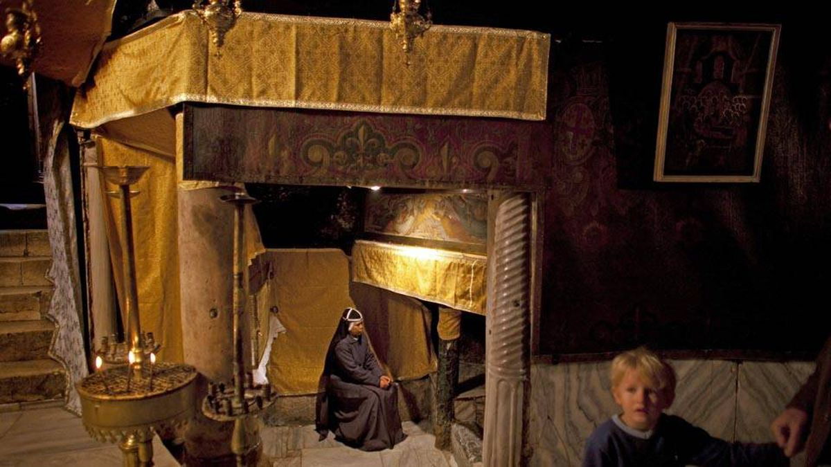 A nun prays in the Grotto of the Church of the Nativity, December 21, 2009 in Bethlehem.
