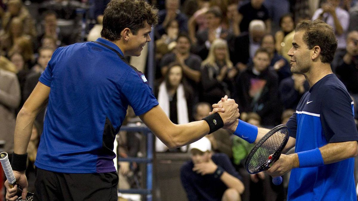 Pete Sampras (right) congratulates Milos Raonic after he won 7-6, 6-1 in a celebrity tennis event in Toronto on Thursday November 17, 2011. THE CANADIAN PRESS/FRANK GUNN