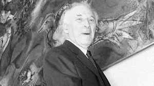 """In this file photo of Sept. 8, 1966, Marc Chagall poses by his mural """"Le Triumphe de la Musique,"""" The Triumph of Music, during the unveiling ceremonies in the lobby of the Metropolitan Opera House at Lincoln Center, New York."""