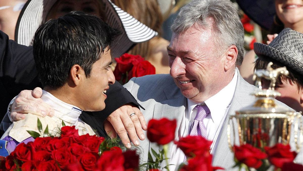Owner of I'll Have Another, Paul Reddam (R) congratulates jockey Mario Gutierrez after they won the 138th Kentucky Derby at Churchill Downs in Louisville, Kentucky, May 5, 2012. REUTERS/Matt Sullivan