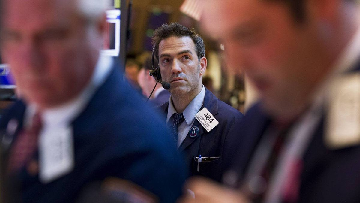 A trader speaks on a headset while waiting for the close of the New York Stock Exchange in New York, in this file photo.