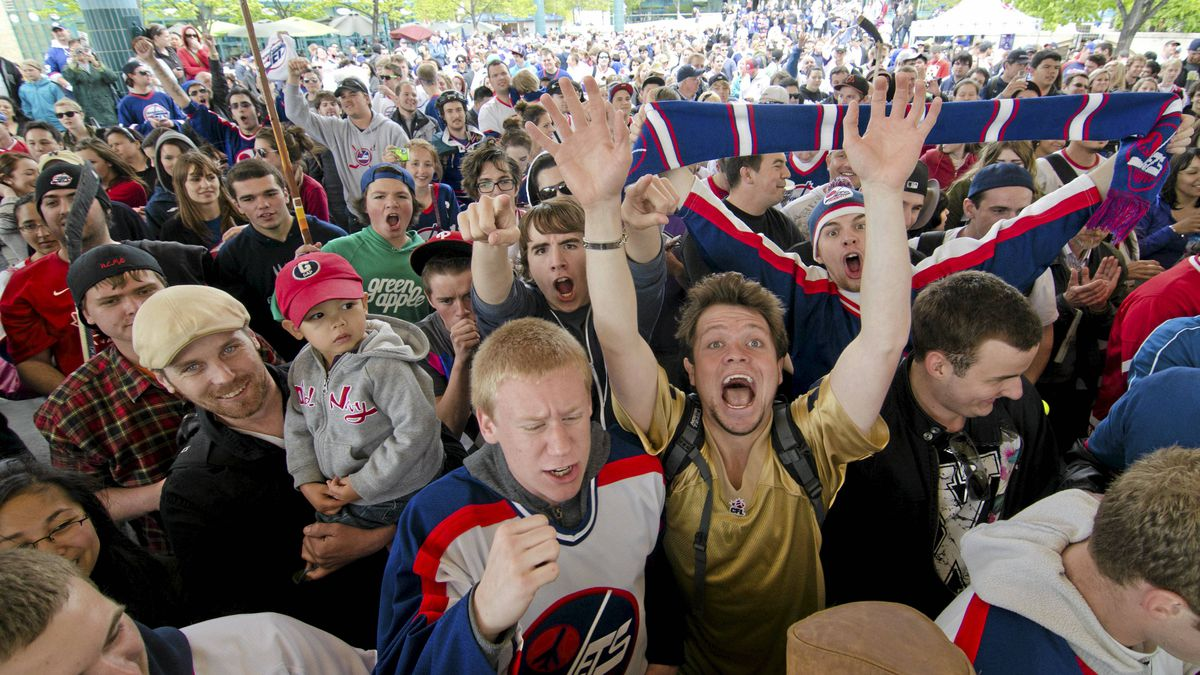 Winnipeg hockey supporters rally at The Forks in Winnipeg, Tuesday May 31, 2011, after the announcement that an NHL team will be returning to the city after 15 years.