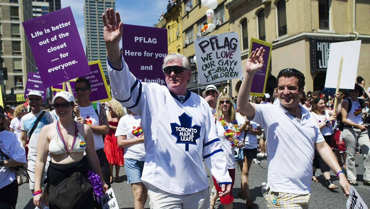 Toronto Maple Leafs General Manager Brian Burke walks with comedian Rick Mercer, right. Mr. Burke marches in memory of his openly gay son Brendan Burke after he passed away in a car accident last year.