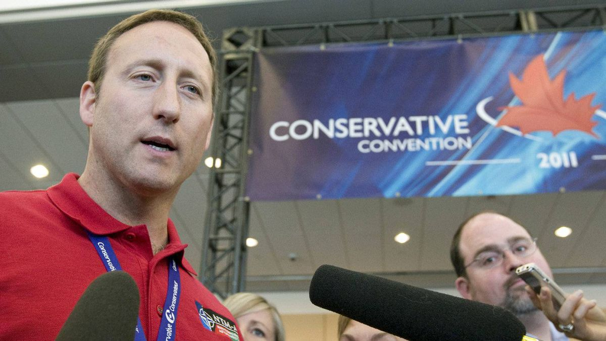 Defence Minister Peter MacKay speaks with reporters at the Conservative Party policy convention in Ottawa ib June 10, 2011.