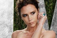 Victoria Beckham poses as she arrives at the 2012 Vanity Fair Oscar party in West Hollywood on Sunday.