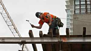 Workers construct another condo development in downtown Vancouver on March 26th, 2010.