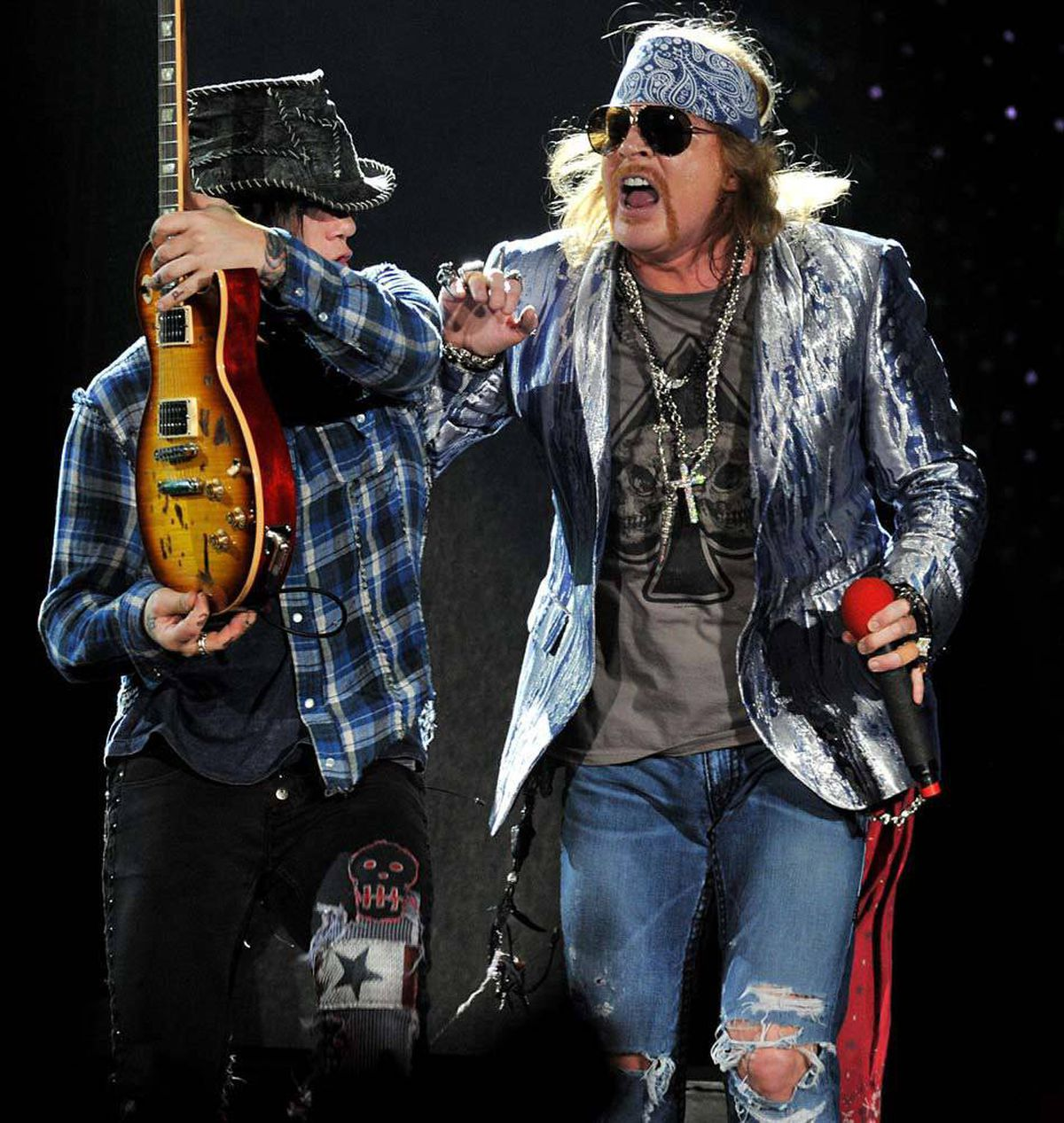 Guns N' Roses guitarist DJ Ashba, left, and singer Axl Rose perform at London's O2 Arena in 2010. The original band broke up in 1996 but Axl Rose still performs under its name.
