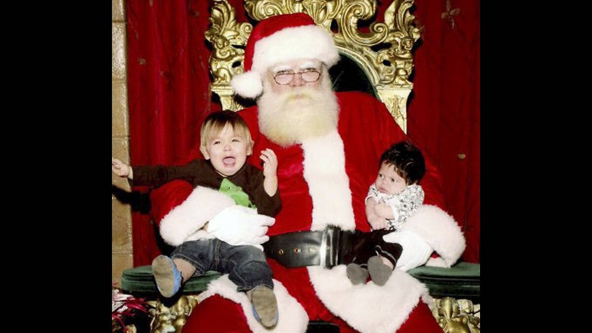 Alison Sigmundson photo: Poor Santa... A rare split second opportunity captured where all 3 people involved look either totally unhappy, or utterly confused!