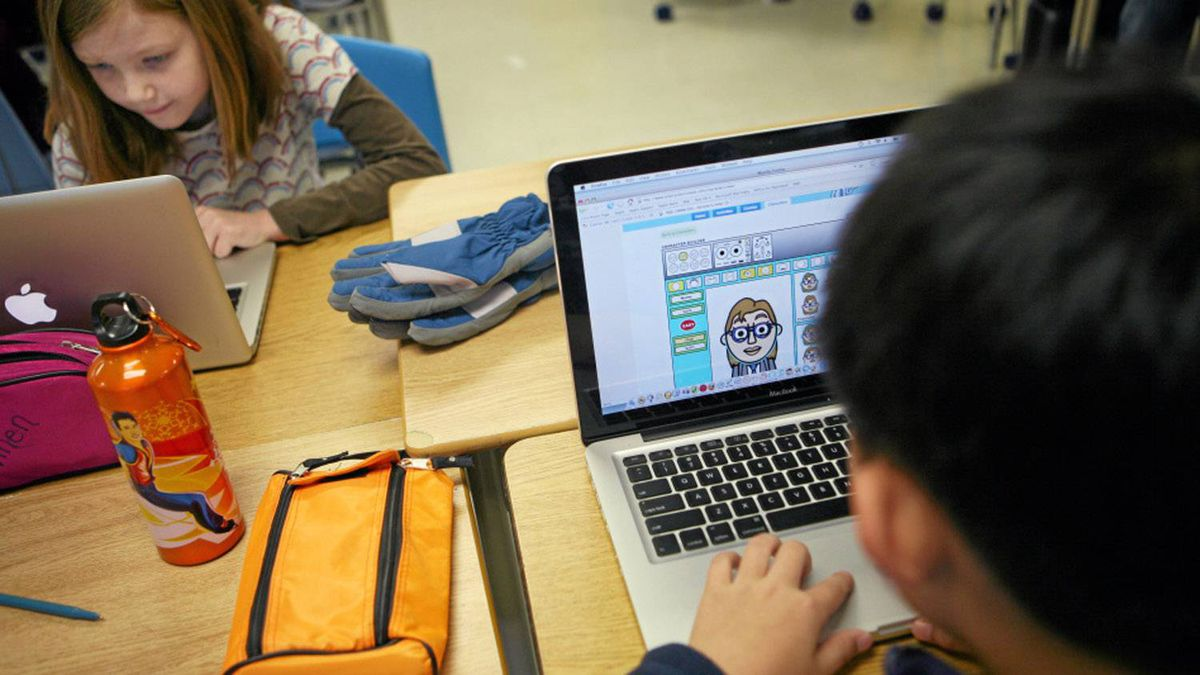 Students work on laptops connected to Wi-Fi.