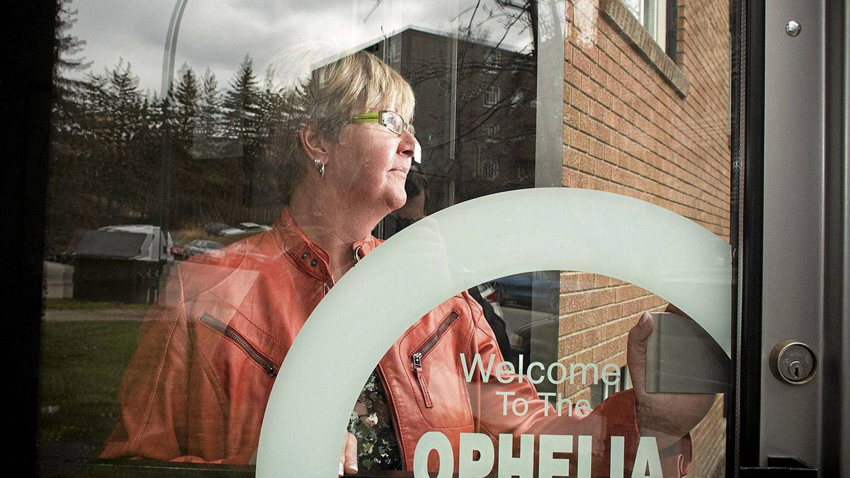 Colette Smithers is photographed in the doorway of her building, a three story housing complex in Calgary's mount royal neighbourhood. Smithers, has lived in the affordable housing for 6 months now since the women-only development was opened. Prior to her moving in she was in transitional housing offered through the YWCA.