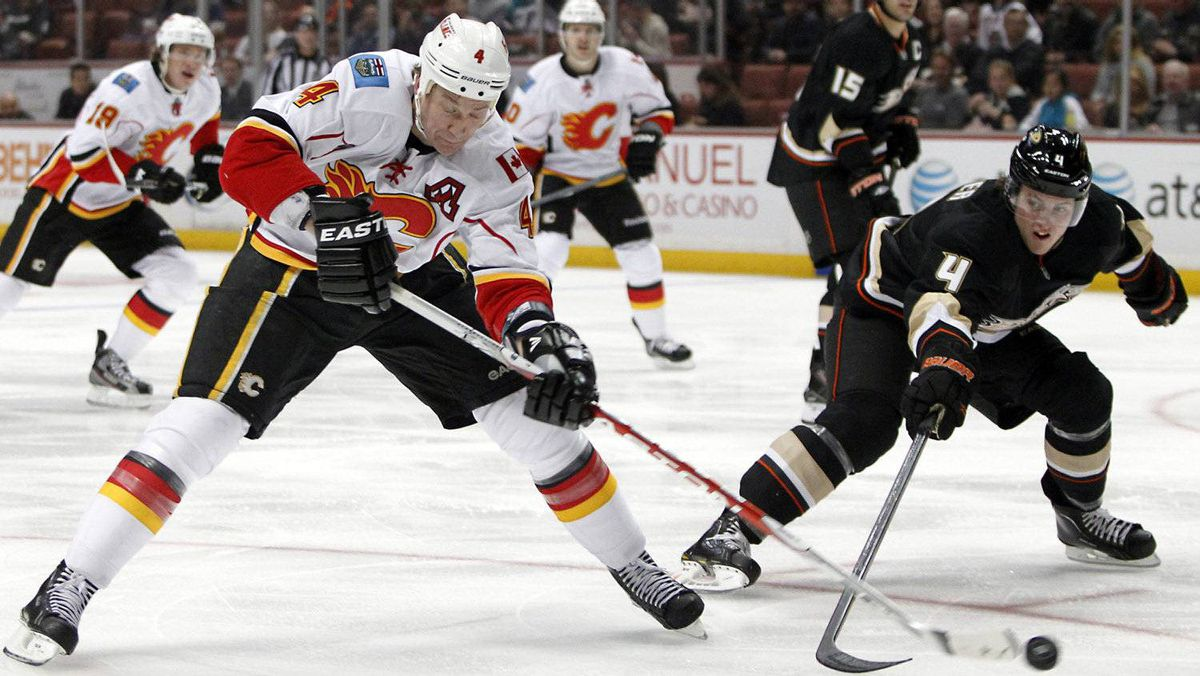 Anaheim Ducks defenseman Cam Fowler, right, tries to hit the puck away from Calgary Flames defenseman Jay Bouwmeester, left, in the first period of an NHL hockey game in Anaheim, Calif., on Feb. 6, 2012. Christine Potter/Associated Press