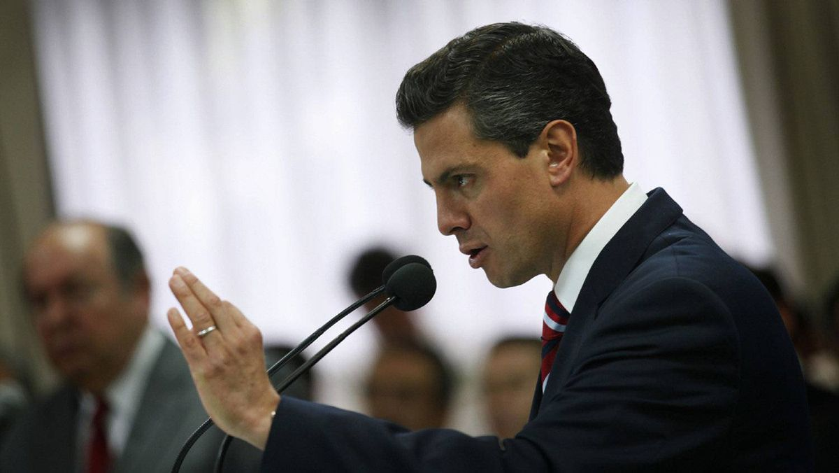 Enrique Pena Nieto, presidential candidate for the opposition Institutional Revolutionary Party (PRI), gestures during a news conference in Mexico City April 8, 2012.