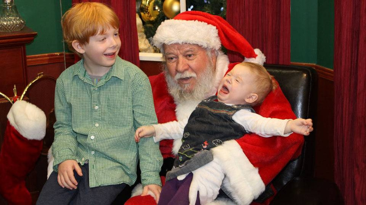 Christine Lavrence writes: Julian, 5, and Sophie, 1, visit Santa this year.