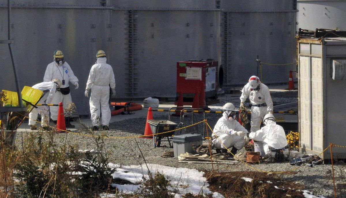 Workers wearing protective suits and masks operate at the crippled Tokyo Electric Power Co. Fukushima Daiichi nuclear power plant in Fukushima prefecture February 28, 2012. Members of the foreign media were allowed into the plant on Tuesday ahead of the first anniversary of the March 11, 2011 tsunami and earthquake which triggered the world's worst nuclear crisis since Chernobyl.