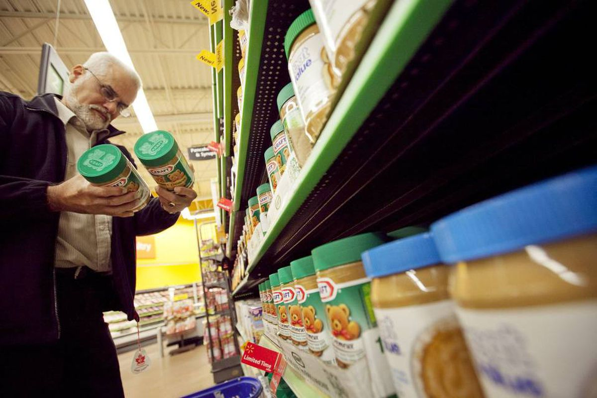 Chuck Nascimento shops for peanut butter at the Heartland Wal-Mart in Mississauga.