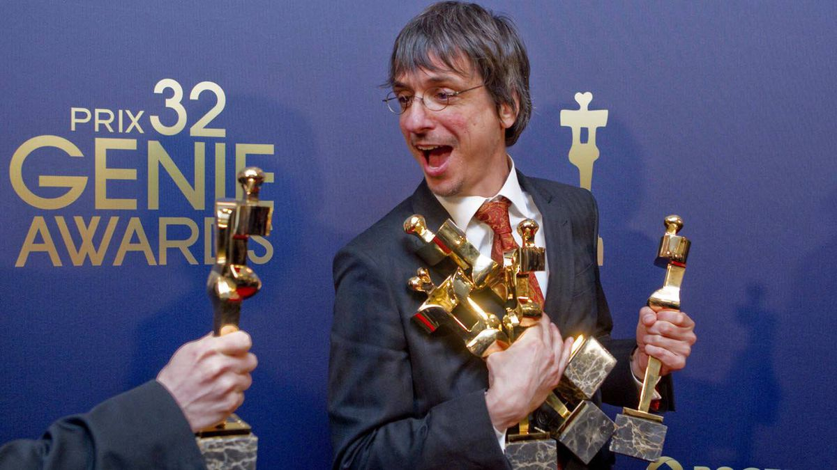 Philippe Falardeau, director of Monsieur Lazhar, reacts as he is handed his sixth award to hold at the 32nd Genie Awards in Toronto on March 8, 2012.