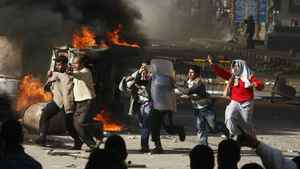 Egyptian demonstrators burn a riot police car during a protest in the northern city of Suez on Jan. 28, 2011 demanding the ouster of President Hosni Mubarak.