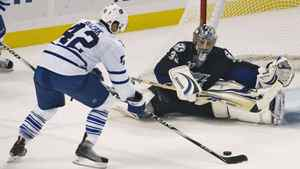 Tampa Bay Lightning goalie Dan Ellis (33) prepares to block a shot from Toronto Maple Leafs center Tyler Bozak (42) during the second period of a NHL hockey game in Tampa, Florida, November 9, 2010.