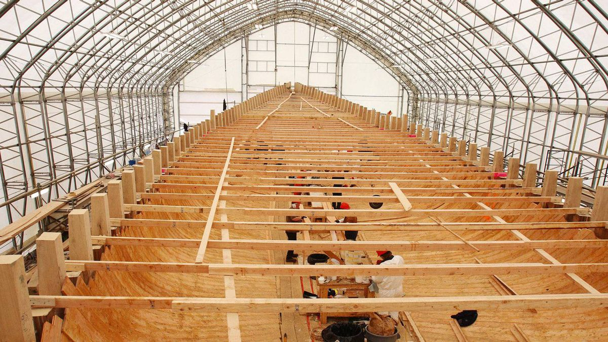 A crew works on what will become the below-deck area of the rebuilt Bluenose.
