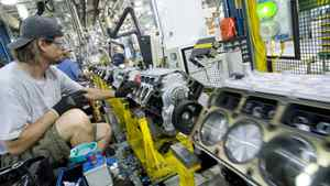 GM Powertrain Plant in St. Catharine's, workers on the line assemble V-8 engines.