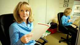 Self employed consultant Tracey White working in her home office.