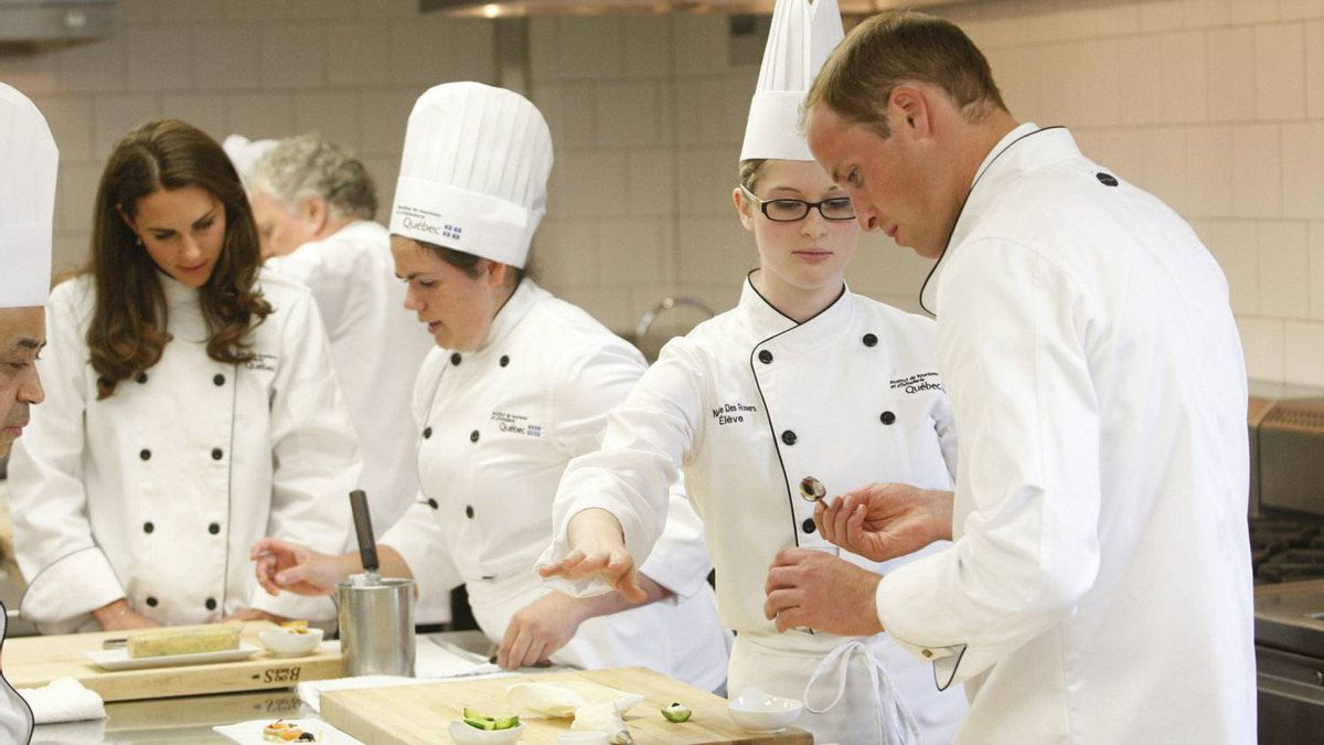 The Duke and Duchess of Cambridge help prepare hors d'oeuvres during a visit to the Quebec Tourism and Hotel Institute in Montreal on Saturday, July 2, 2011.
