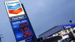 Gasoline topped $5 (U.S.) a gallon at a Chevron station in downtown Los Angeles in March. The U.S. Federal Reserve says in its latest 'Beige Book' report that high fuel prices are casting a shadow on the nation's business outlook.