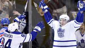 Toronto Maple Leafs forward Nikolai Kulemin celebrates his goal against the New York Rangers with teammate Mikhail Grabovski (L) during the overtime period of their NHL hockey game in Toronto March 27, 2010. REUTERS/Mike Cassese