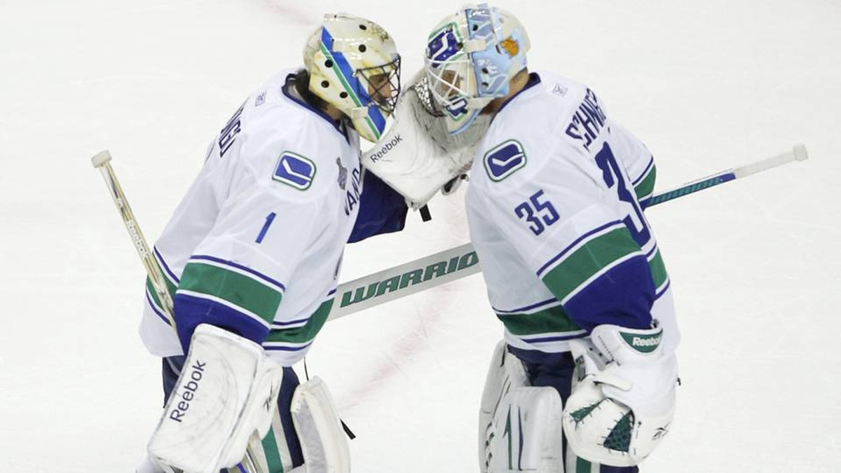 ancouver Canucks' Roberto Luongo (L) leaves the game as backup goalie Cory Schneider comes in against the Boston Bruins during the first period.