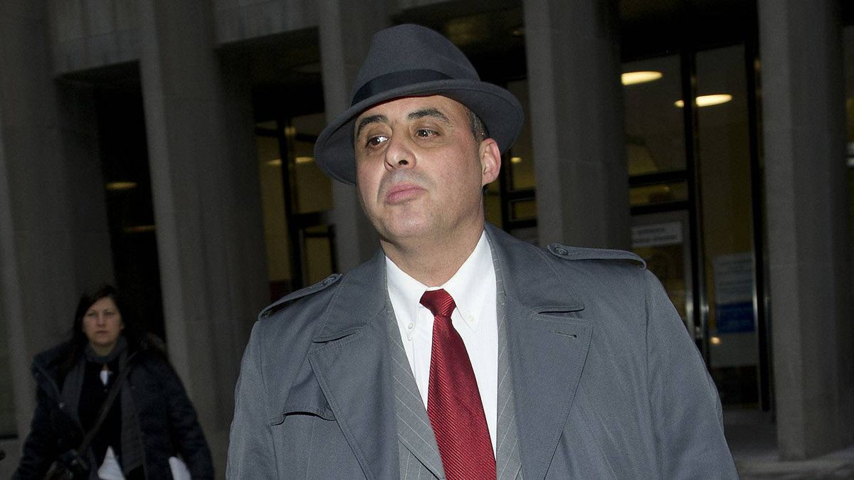 Steven Correia, who was charged with conspiracy to attempt to obstruct justice, attempt to obstruct justice, extortion, theft over $5,000 and perjury, is photographed leaving court in Toronto, Ont. on January 16, 2012.