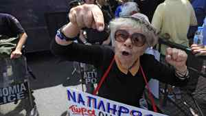 A pensioner takes part in a protest rally during a 24-hour strike against a new austerity package in Athens June 9, 2011.