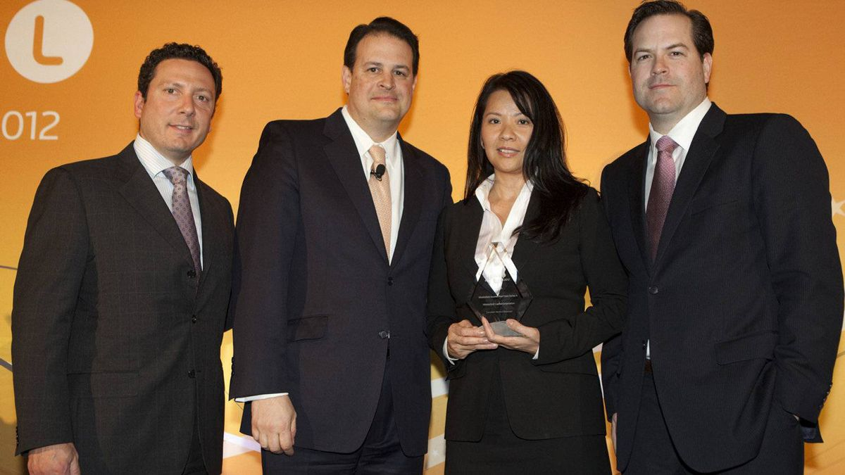 Jim Weber of Thomson Reuters, second from left, with winners of the Middlefield Income Plus Class Series A fund.
